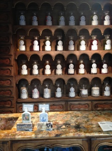 Shelves lines with glass jars of precious oils.